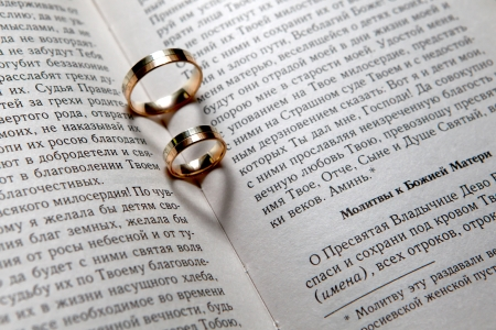 Wedding rings with shadows like hearts in Bible photo
