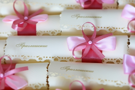 Wedding invitation decorated with the pink bows photo