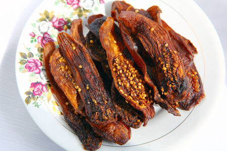 Pieces of dried aubergines on plate with spices ready to eat