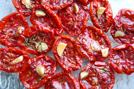 A plate with dried tomatoes with garlic and rozemary