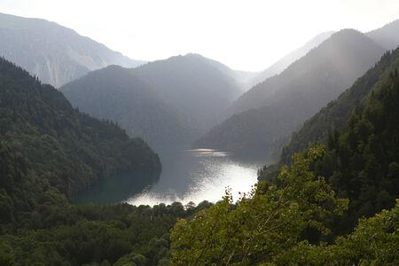 Ritsa lake, Abkhazia, 950 m above sea level, summer evening after rain Stock Photo
