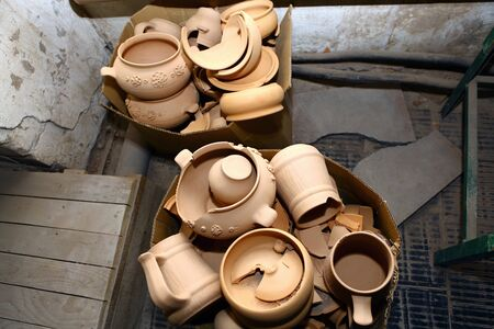 clay craft: Broken pots on ceramic factory in Borisovka