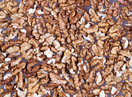 cleared: Background of cleared raw walnuts on table
