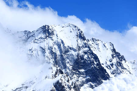 dombay: Mountain peaks in sun windy day. Caucasus Mountains, region Dombay.