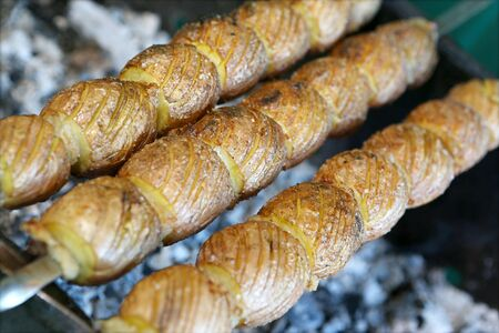 oiled: Salted and oiled potato prepared on charcoal Stock Photo