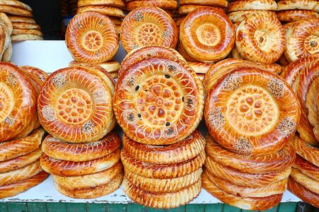 Flat cakes from tandoor on market counter in Bishkek, Kyrgyzstan