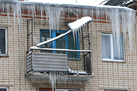The icicles which are hanging down from the rooftop in Russia
