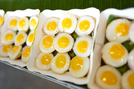 Boxes with fried eggs on Thailand market