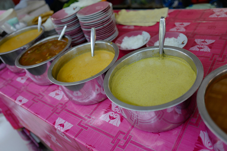 Pans with national Thai soup in the market of Phuket Stock Photo