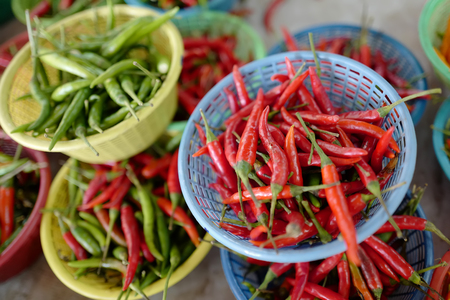 Red and green chile pepper on thai market