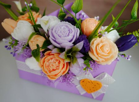 Bouquet of flowers from soap in a box of color of a lavender 스톡 콘텐츠