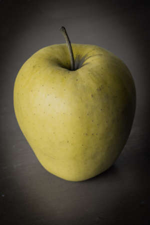 yellow apple: Yellow apple in dark point of view