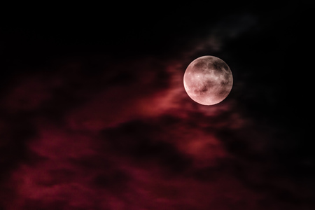 Red moon in a dark night