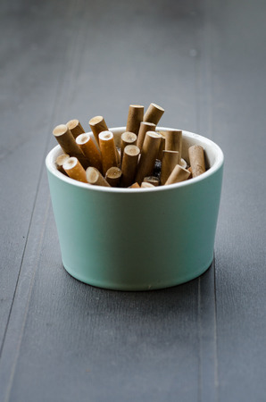 Ashtray full of cigarettes on a table Stock Photo