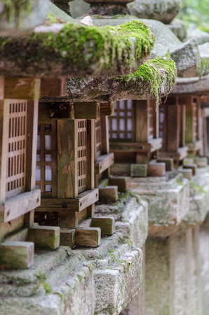 traditional japanese wood and stone lanterns