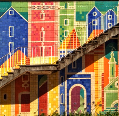 tile: A wall full of azulejos tiles forming an amazing mosaic in a suburb inLisbon Portugal