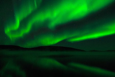 Aurora Borealis - Northern: Aurora borealis commonly called as northern lights can be seen in higher latitudes. It can be seen on winter months and they are a breath taking experience. This particular image was made at Ukkonjarvi Lake near Inari in Finnis Stock Photo