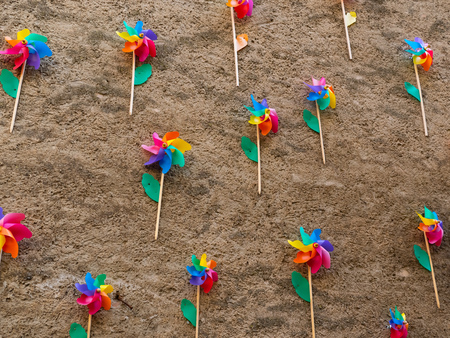 A Wall with many colored pinwheels