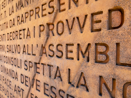 A wall on which the Italian constitution is carved. - Useful as a background.