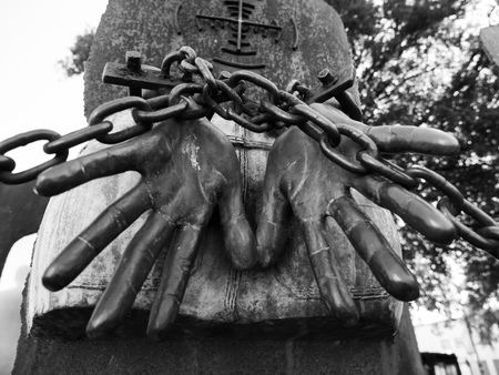 Hands chained for an unknown reason