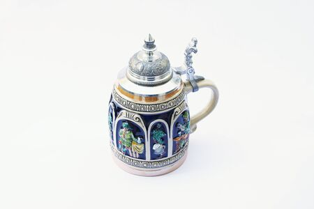 pewter mug: The photograph beautifully decorated traditional German mug for beer. Stock Photo