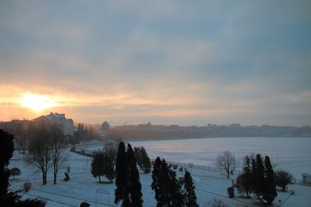 The photo was taken a winter day in the city of Ternopil in Ukraine. There is little snow. Very cold. Lake in the heart of the city froze.