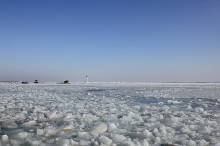 almost all: The picture was taken in Ukraine in Odessa. The picture shows the harbor of Odessa seaport. In winter 2012 there were strong frosts. Sea froze almost all of the Odessa bay.
