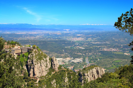 The picture was taken in Spain in the spring. The picture shows the view from the top of the mountain of Montserrat.