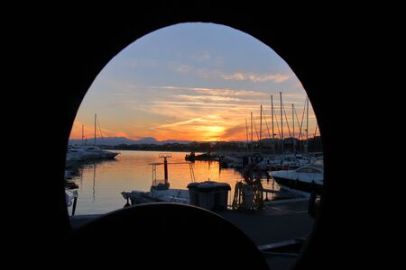 The picture was taken in Spain, Salou. Survey was carried out from the window standing on a yacht repair. The picture shows a sunset over the marina.
