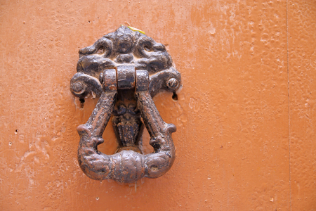 The picture was taken in Spain, in the ancient city of Tarragona. The picture shows an old device for tying horses.