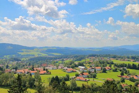trip over: The picture was taken in Germany, near the town of Grafenau. In the picture visible cloud landscape Bavarian valleys and hills covered with forests.