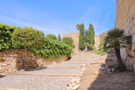 The picture was taken in Spain, in the ancient city of Tarragona. The picture shows the path along the ancient wall around the old part of the city. Reklamní fotografie