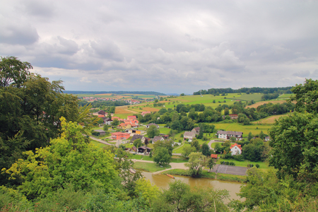 hushed: The picture was taken in Germany, near the town of Kelheim on the shore of the Danube. The picture shows the river valley, hushed before the storm.