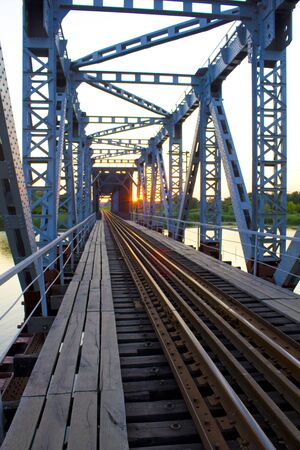 In the picture the old iron bridge. The picture was taken in Ukraine in July.