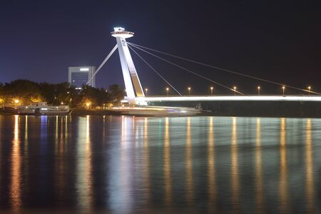 futuristic: In the photo The new bridge in Bratislava at night. The picture was taken from the Danube embankment.