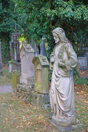 The photo was taken in the German city of Straubing. The picture shows the old monuments of the ancient cemetery at the monastery.