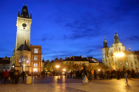 Photo taken in Prague. The photograph shows Old Town Square in the evening against a dark blue sky. Фото со стока