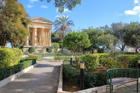 The picture was taken in the city garden of the island of Malta in the month of January. The picture shows a green flowering park on a sunny day.