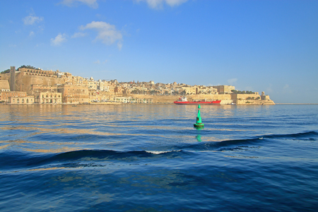 The photo was taken on the island of Malta in the month of January. The picture shows an island bay with the visible city of Valletta. Stok Fotoğraf