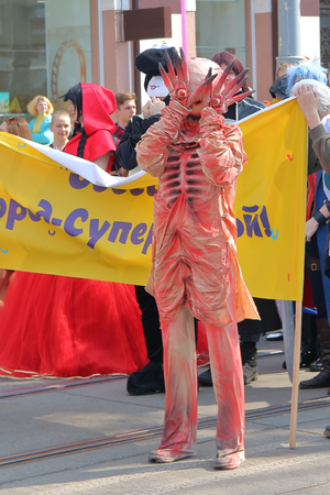 ODESSA, UKRAINE - APRIL 01, 2019. The photo shows an actor in the form of a monster in a demonstration in honor of the traditional festival of humor and laughter in Odessa.