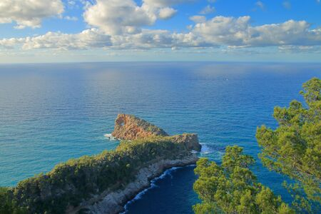 Photo taken on the island of Palma de Mallorca. The picture shows a seascape with a long cape in the foreground.