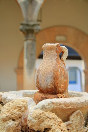 Photo taken in the city of Palma. The picture shows the original decor of the fountain in the form of a jug. The jug has a red tinge due to mineral water. 写真素材