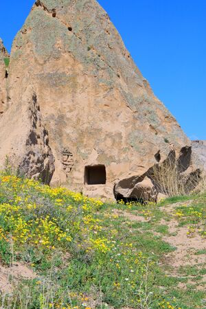 Photo taken in Turkey. The picture shows a mountain trail to ancient abandoned cave dwellings in Cappadocia. 版權商用圖片