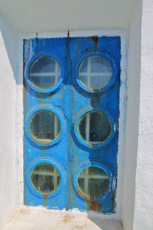 The photo was taken in the city of Odessa in Ukraine. The picture shows an unusual window of an old lighthouse. Stockfoto
