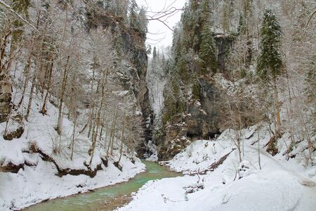 The picture was taken in Germany in the vicinity of the city of Garmisch-Partenkirchen. The photo shows the river flowing through a gorge in the mountains. Nearby is a trail for walks in the forest. 스톡 콘텐츠