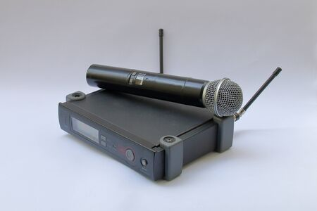 Pictured Wireless microphone included with the base on a white background. Foto de archivo