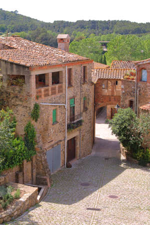 The picture was taken in Spain, in the province of Girona. The picture shows one of the many picturesque villages of the province. 新闻类图片