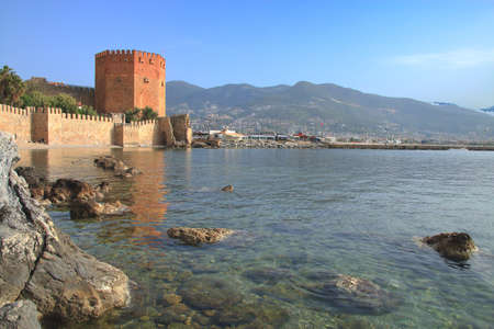 Photo taken in Turkey. The picture shows the red tower in the harbor of Alanya. 新闻类图片