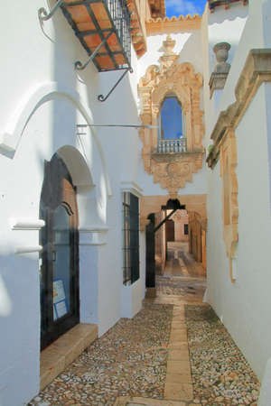 The photo was taken on the island of Palma de Mallorca, in the city of Palma. The picture shows the narrow street of the old Spanish region.