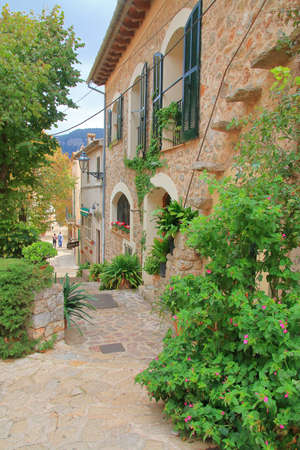 Photo taken on the island of Palma de Mallorca. The picture shows the narrow streets of an old village called Valldemossa in the mountains of the island.